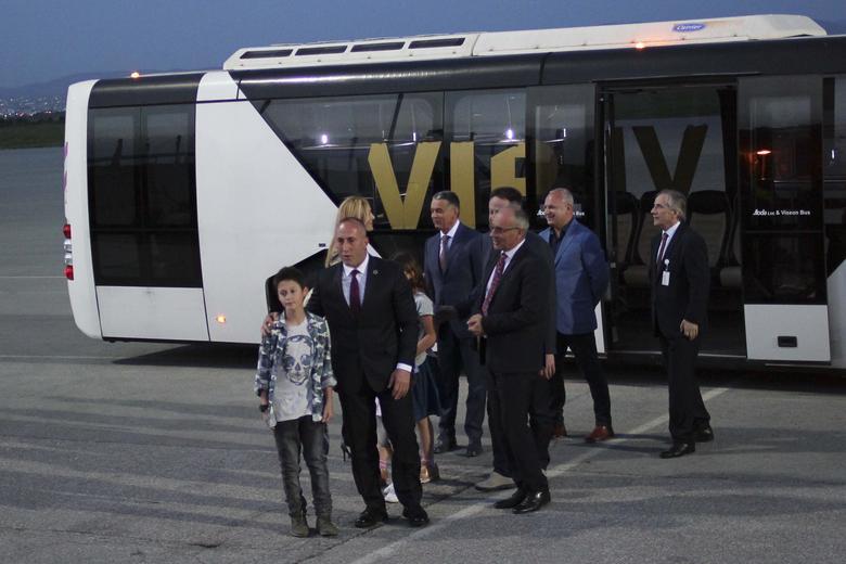 Former Kosovo Prime Minister Ramush Haradinaj is welcomed by his family at Pristina International Airport Adem Jashari in Pristina  April 27, 2017. REUTERS/Agron Beqiri