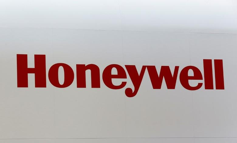 FILE PHOTO: A Honeywell logo is pictured on the company booth during the European Business Aviation Convention & Exhibition (EBACE) at Cointrin airport in Geneva, Switzerland, May 24, 2016.  REUTERS/Denis Balibouse