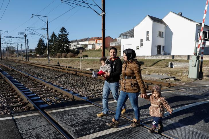 Syrian Mohamed al-Khalaf, (2nd L) carries daughter Maya alongside his wife Ghufran (2nd R) and their daughter Shadin near their apartment in Wecker, Luxembourg, January 19, 2017. Picture taken January 19, 2017.   To match Insight EUROPE-MIGRANTS/RAQQA      REUTERS/Yves Herman