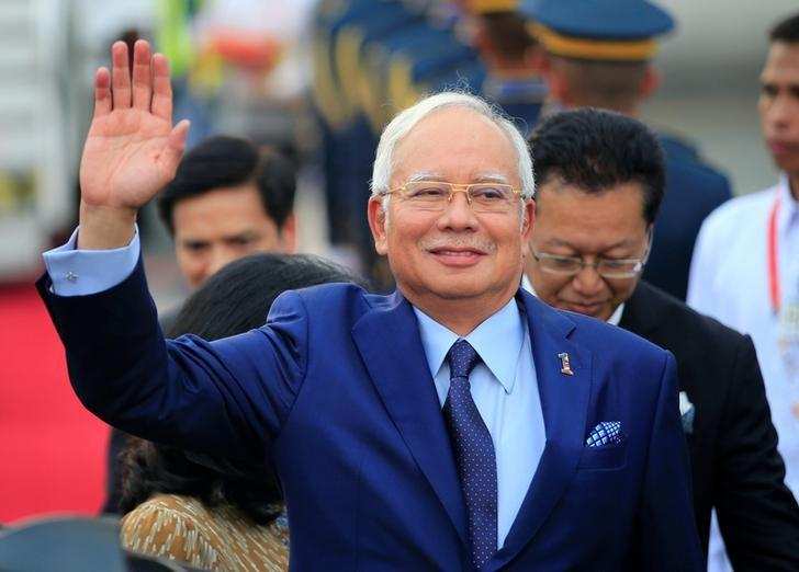 Malaysian Prime Minister Razak Najib waves to photographers upon arrival at the Manila International Airport in Pasay city, metro Manila, Philippines April 27, 2017. REUTERS/Romeo Ranoco