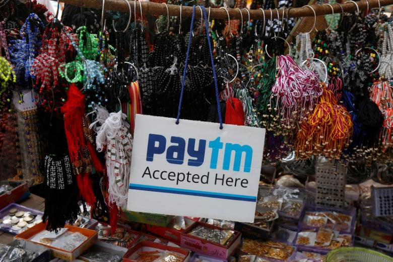 An advertisement of Paytm, a digital wallet company, is pictured at a road side stall in Kolkata, India, January 25, 2017.  REUTERS/Rupak De Chowdhuri