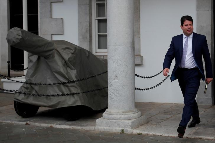 Gibraltar's Chief Minister Fabian Picardo walks past an old canon as he leaves Convent Palace in the British overseas territory of Gibraltar, historically claimed by Spain April 3, 2017. REUTERS/Jon Nazca