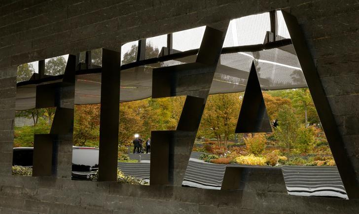 A TV team is reflected in a logo of FIFA a meeting of the FIFA Council at its headquarters in Zurich, Switzerland October 13, 2016.  REUTERS/Arnd Wiegmann/File Photo