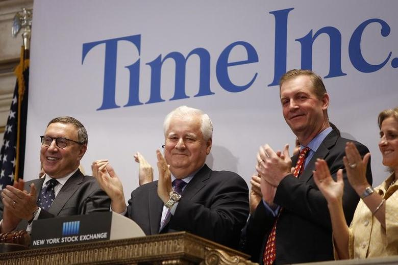 Time Inc. CEO Joe Ripp (2nd L) claps after ringing the bell to open trading at the New York Stock Exchange in New York June 9, 2014. REUTERS/Carlo Allegri/File Photo