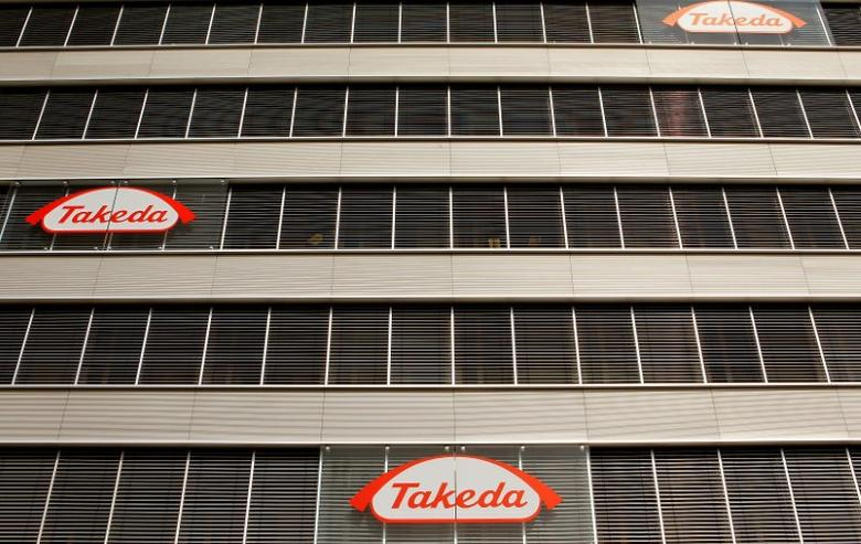 Logos of Japanese Takeda Pharmaceutical Co are seen at an office building in Glattbrugg near Zurich March 7, 2012.   REUTERS/Arnd Wiegmann/File Photo /File Photo