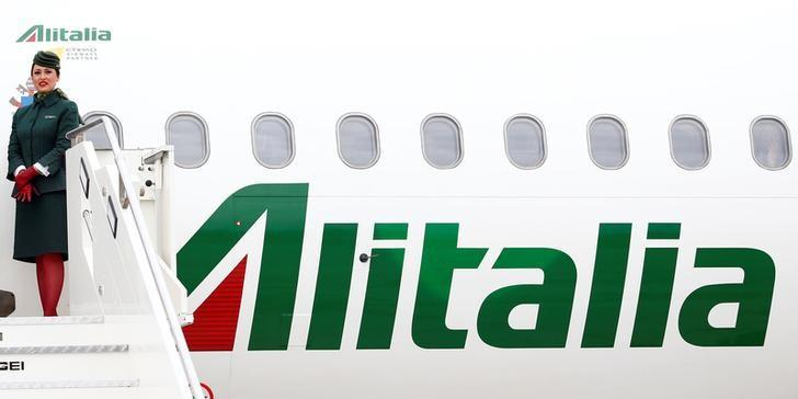 Alitalia's flight attendant is seen at the Leonardo da Vinci-Fiumicino Airport in Rome, Italy, April 28, 2017. REUTERS/Tony Gentile