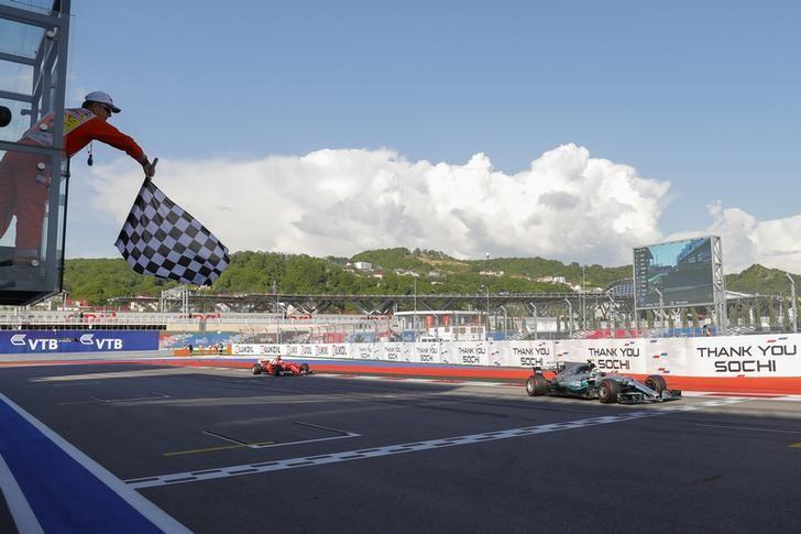 Formula One - F1 - Russian Grand Prix - Sochi, Russia - 30/04/17 - Mercedes Formula One driver Valtteri Bottas of Finland crosses the finish line and wins the race. REUTERS/Valdrin Xhemaj/Pool