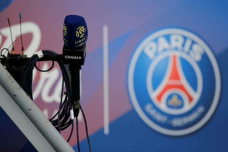 Football Soccer - Paris St Germain v Montpellier - French Ligue 1 - Parc des Princes, Paris, France - 22/4/17. The logo of Paris St Germain's club is pictured near the logo of French TV channel 'Canal Plus' on a microphone. REUTERS/Stephane Mahe