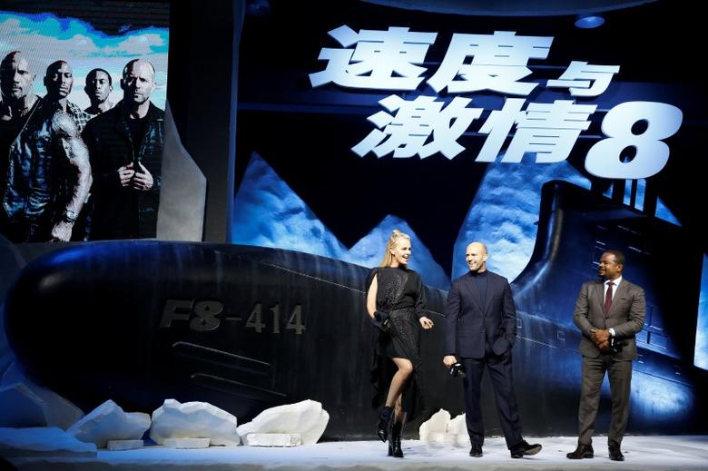 Actor Charlize Theron (L) and Jason Statham (C) and Director F. Gary Gray attend a media event for the new film ''The Fate of the Furious'' in Beijing, China March 23, 2017. REUTERS/Aly Song