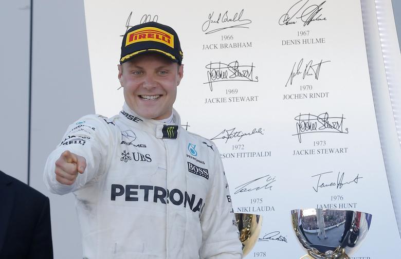 Formula One - F1 - Russian Grand Prix - Sochi, Russia - 30/04/17 - Mercedes Formula One driver Valtteri Bottas of Finland celebrates the victory after the race. REUTERS/Maxim Shemetov