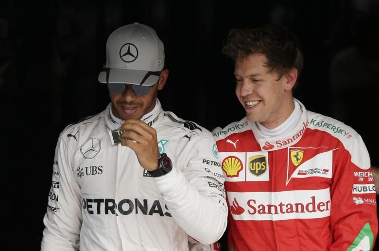 Formula One - F1 - Italian Grand Prix 2016 - Autodromo Nazionale Monza, Monza, Italy - 3/9/16Mercedes' Lewis Hamilton and Ferrari's Sebastian Vettel after qualifyingReuters / Max RossiLivepic