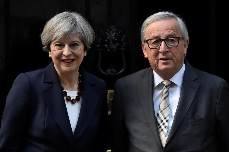 Britain's Prime Minister Theresa May welcomes European Commission President Jean-Claude Juncker to Downing Street in London, Britain April 26, 2017. REUTERS/Hannah McKay