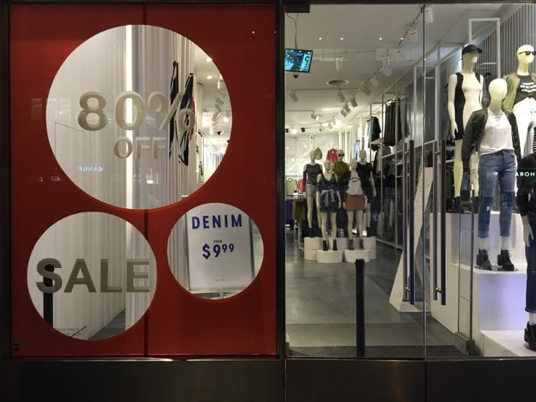 FILE PHOTO: An H&M store has sale signs in the window in New York City,  U.S., August 11, 2016.  REUTERS/Joe White