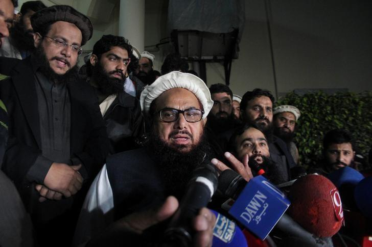 Hafiz Muhammad Saeed, chief of the banned Islamic charity Jamat-ud-Dawa, speaks with media as he is escorted to his home where he will be under house arrest in Lahore, Pakistan January 30, 2017. REUTERS/Stringer