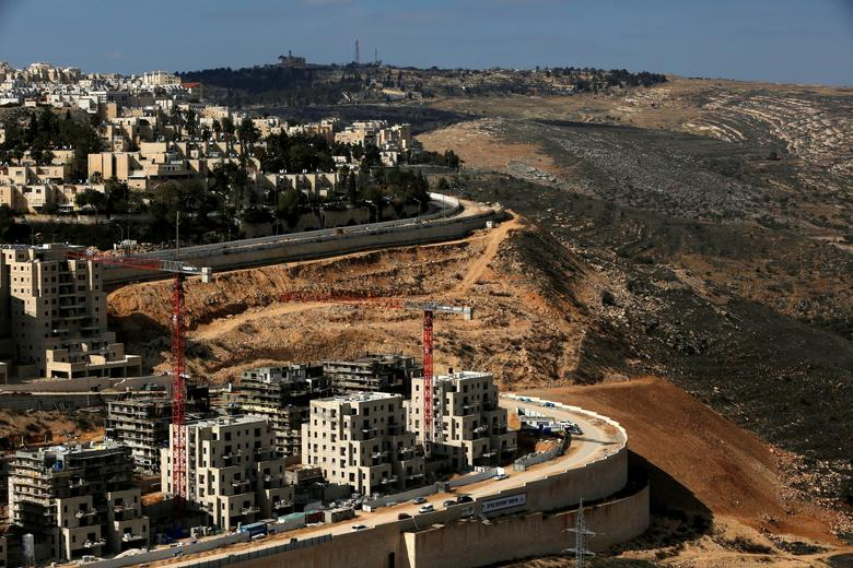 FILE PHOTO: A general view shows the Israeli settlement of Ramot in an area of the occupied West Bank that Israel annexed to Jerusalem January 22, 2017. REUTERS/Ronen Zvulun/File photo