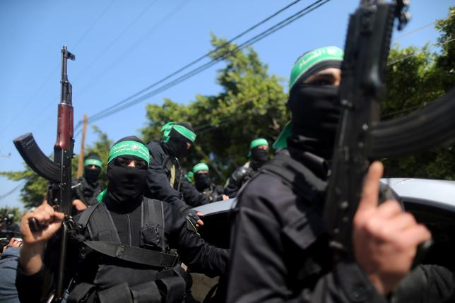 FILE PHOTO - Palestinian members of Hamas's armed wing take part in the funeral of a senior militant in Gaza City March 25, 2017. REUTERS/Mohammed Salem/File Photo