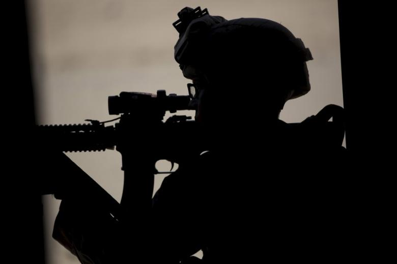 FILE PHOTO: A U.S. Marine  aims his weapon during a non-live fire Military Operations in Urban Terrain (MOUT) training at US Marine Corps: Marines Air Ground Combat Center in Twentynine Palms, California September 1, 2015. REUTERS/Mario Anzuoni