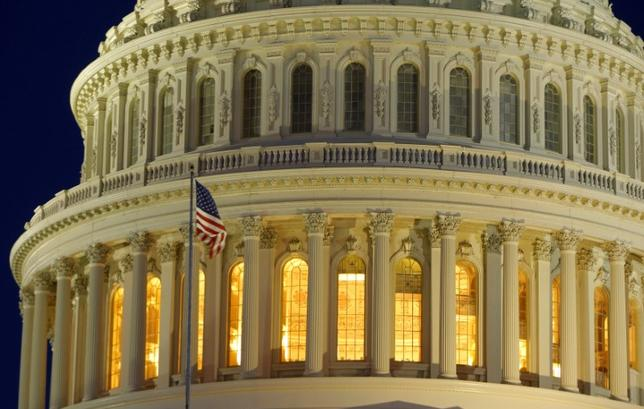 The U.S. Capitol Dome is seen before dawn in Washington.  REUTERS/Gary Cameron/Files