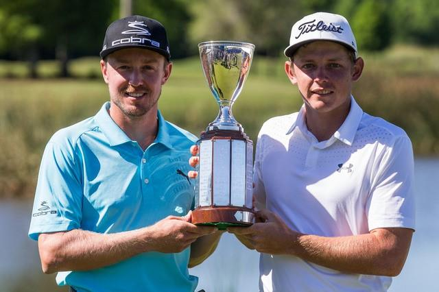 May 1, 2017; Avondale, LA, USA; Jonas Blixt (left) and  Cameron Smith (right) hold the Zurich Classic championship trophy after winning the sudden-death playoff at TPC Louisiana. Stephen Lew-USA TODAY Sports