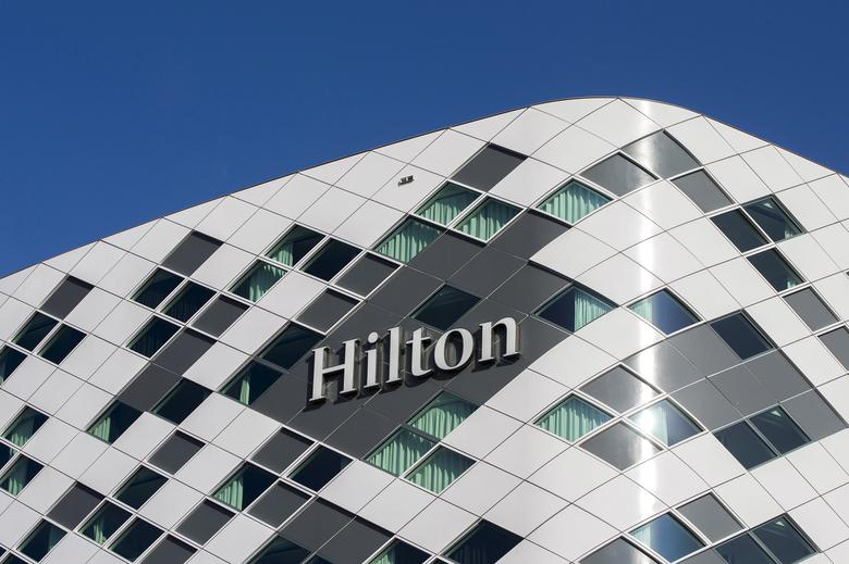 FILE PHOTO: The logo of an Hilton hotel is seen at Schiphol airport near the city of Amsterdam, the Netherlands March 16, 2016.  REUTERS/Yves Herman/File Photo