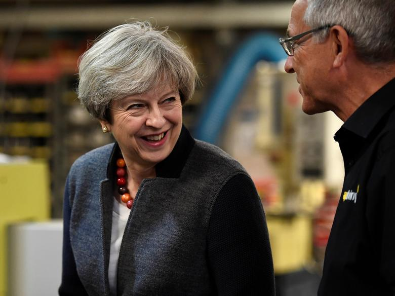 Britain's Prime Minister Theresa May makes a campaign stop at a company in St Yves, Cornwall, May 2, 2017. REUTERS/Dylan Martinez