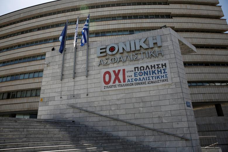 A banner hangs under the logo of National Insurance, a unit of National Bank of Greece, at the company's headquarters in Athens, Greece May 2, 2017. The banner reads ''No to the sale of National Insurance''. REUTERS/Alkis Konstantinidis