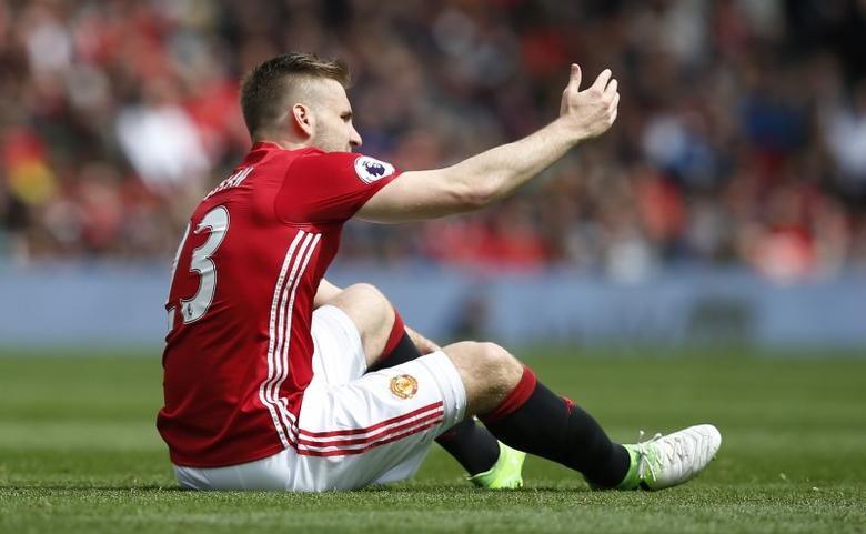 Britain Football Soccer - Manchester United v Swansea City - Premier League - Old Trafford - 30/4/17 Manchester United's Luke Shaw sits injured before being substituted  Reuters / Andrew Yates Livepic