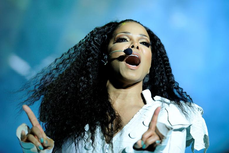 FILE PHOTO: U.S. singer Janet Jackson performs on stage during her  ''Number Ones - Up Close and Personal'' tour at the Royal Albert Hall in London June 30, 2011. REUTERS/Dylan Martinez/File Photo