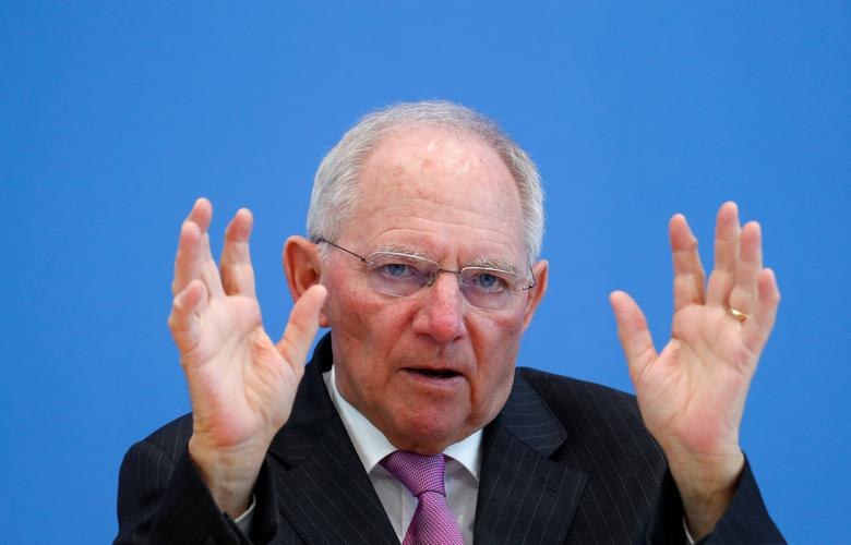 FILE PHOTO: German Finance Minister Wolfgang Schaeuble presents draft budget for 2018 and mid-term plans for state spending until 2021 during a news conference in Berlin, Germany, March 15, 2017.     REUTERS/Fabrizio Bensch/File Photo