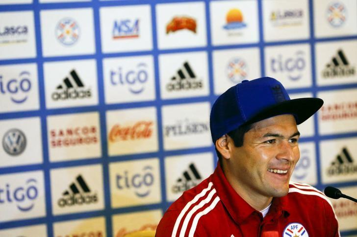 Paraguay's Pablo Aguilar smiles as he talks to the media during a news conference in Concepcion, Chile, June 28, 2015.  REUTERS/Carlos Garcia Rawlins/File Photo