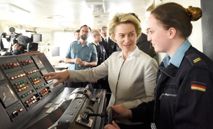 German Defense Minister Ursula von der Leyen talks to a soldier of German special naval forces during her visit at the German army ''Bundeswehr'' in Kiel, Germany April 21, 2017.  REUTERS/Fabian Bimmer