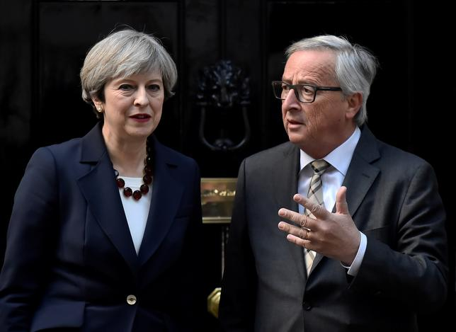 Britain's Prime Minister Theresa May welcomes Head of the European Commission, President Jean-Claude Juncker to Downing Street in London, Britain April 26, 2017. REUTERS/Hannah McKay