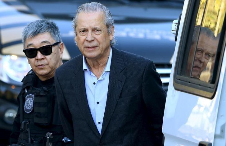 FILE PHOTO: Jose Dirceu (R), former Brazilian President Luiz Inacio Lula da Silva's chief of staff, is escorted by federal police officer Newton Ishii as he leaves the Federal Police headquarters to give his testimony in a session of the Parliamentary Committee of Inquiry in Curitiba, Brazil, August 31, 2015. REUTERS/Rodolfo Buhrer