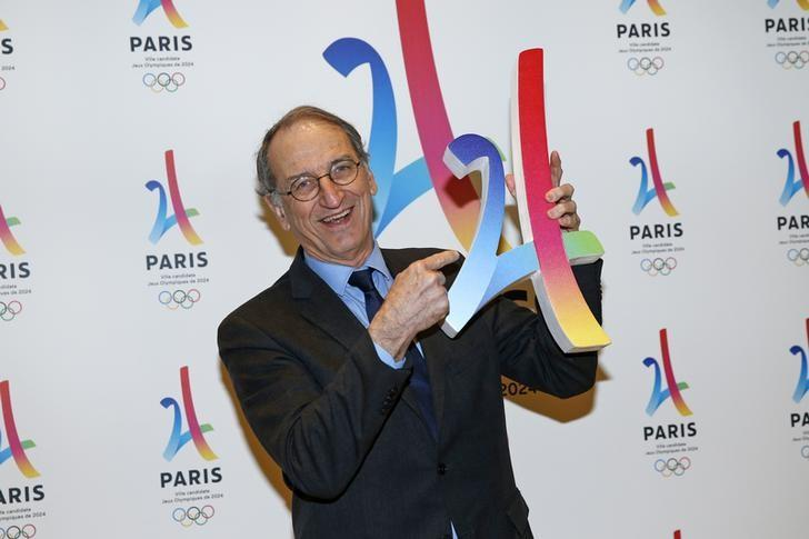 President of the French National Olympic and Sports Committee Denis Masseglia holds the logo as he attends the presentation of the Paris candidacy for the 2024 Olympic and Paralympic Games in Paris, France, February 17, 2016. REUTERS/Benoit Tessier/Files
