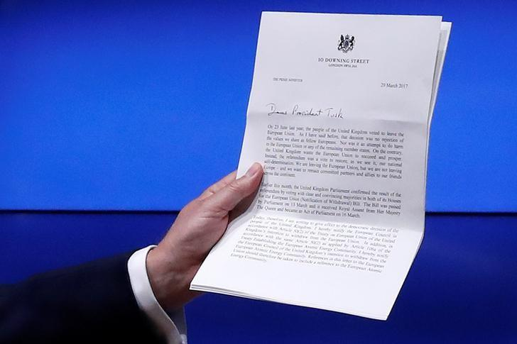 European Council President Donald Tusk shows British Prime Minister Theresa May's Brexit letter in notice of the UK's intention to leave the bloc under Article 50 of the EU's Lisbon Treaty, at the end of a news conference in Brussels, Belgium March 29, 2017. REUTERS/Yves Herman