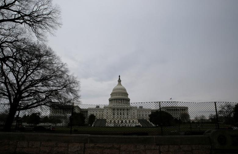 The U.S. Capitol building is seen as the U.S. House of Representatives prepare for a planned vote on the American Health Care Act, promoted by House Republicans and the Trump administration to repeal and replace the Affordable Care Act act known as Obamacare, on Capitol Hill in Washington, U.S., March 24, 2017. REUTERS/Jim Bourg