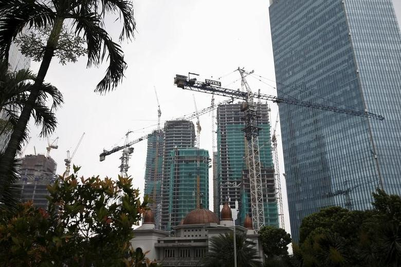 Cranes are seen at a construction site inside Jakarta's business district, Indonesia February 23, 2016. REUTERS/Darren Whiteside