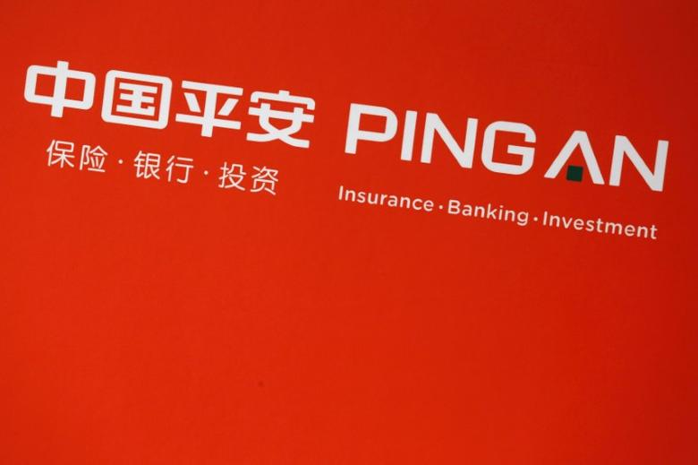 FILE PHOTO: Company logo of Ping An Insurance Group is shown at a news conference following the company's announcement of its annual results in Hong Kong, China March 16, 2016.   REUTERS/Bobby Yip/File Photo