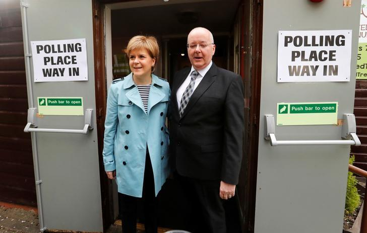 Nicola Sturgeon and her husband Peter Murrell arrive to vote in local elections at a polling station in Glasgow, Scotland, May 4, 2017. REUTERS/Russell Cheyne