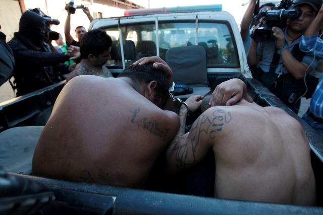 FILE PHOTO: Members of the 18th Street Gang are presented to the media after being detained under charges of trafficking and robbery in Puerto El Triunfo, El Salvador, February 8, 2017. REUTERS/Jose Cabezas/File Photo