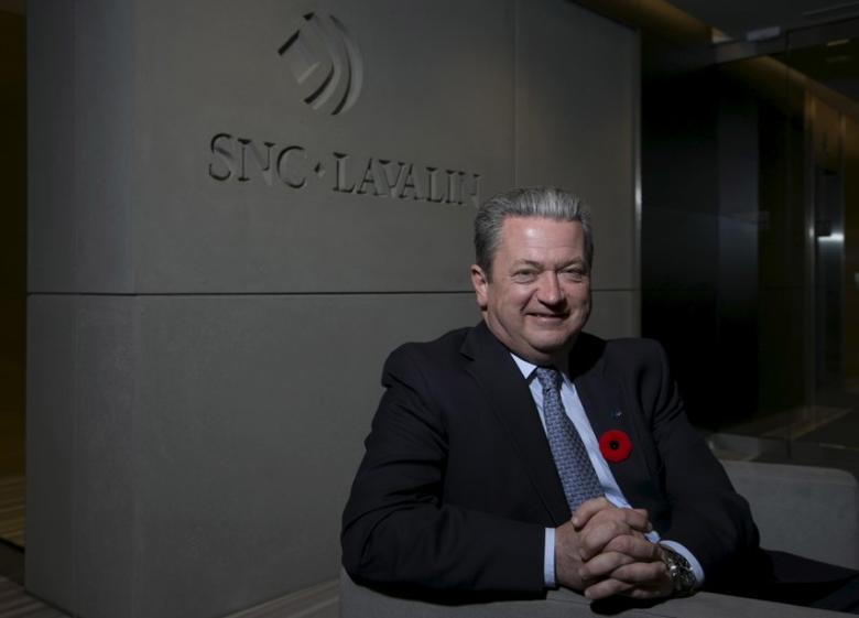 FILE PHOTO: Neil Bruce, president and CEO of SNC-Lavalin, poses in their head offices in Montreal, November 10, 2015.  REUTERS/Christinne Muschi