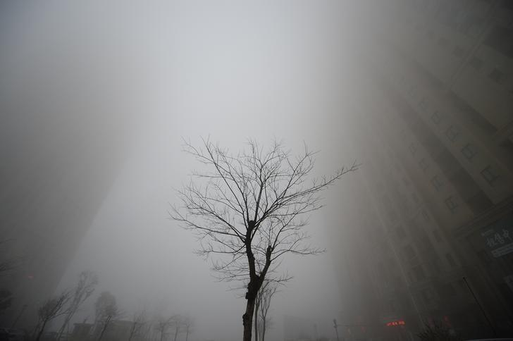 REPRESENTATIVE IMAGE - Buildings are seen in heavy smog during a polluted day in Jinan, Shandong province, China, December 20, 2016. REUTERS/Stringer/File Photo