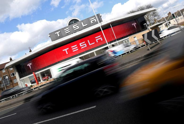 FILE PHOTO: A Tesla car showroom is seen in west London, Britain on March 21, 2017.  REUTERS/Toby Melville/File Photo