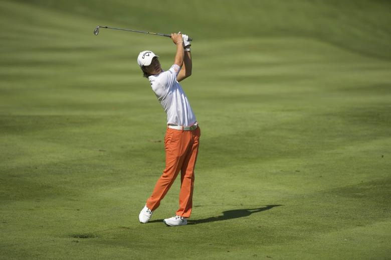 Jul 31, 2015; Gainesville, VA, USA; Ryo Ishikawa hits his second shot on the 11th hole in the second round of the Quicken Loans National golf tournament at Robert Trent Jones Golf Club. Mandatory Credit: Rafael Suanes-USA TODAY Sports