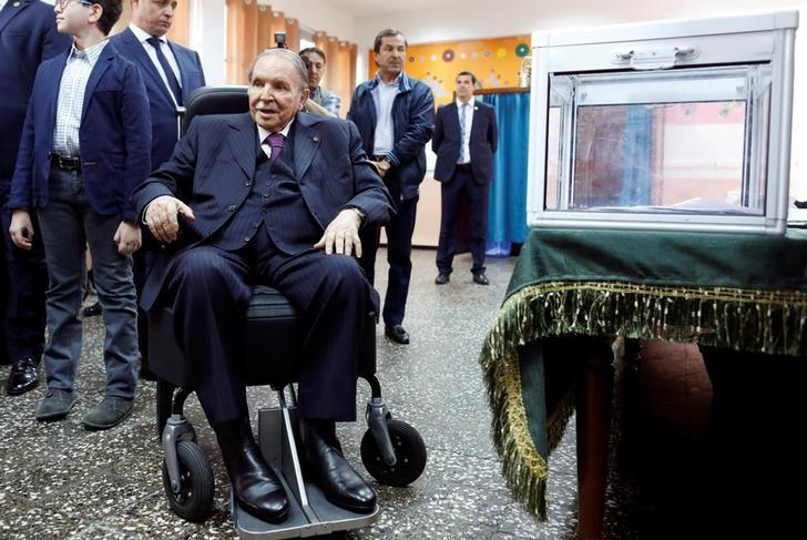 Algeria's President Abdelaziz Bouteflika looks at journalists after casting his ballot during the parliamentary election in Algiers, Algeria, May 4, 2017. REUTERS/Zohra Bensemra