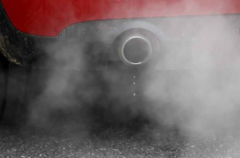 An exhaust emits fumes as a car is driven through Richmond in London, Britain December 2, 2016. REUTERS/Peter Nicholls/Files