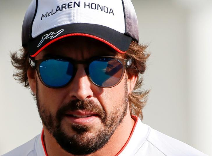 Formula One - Japanese Grand Prix - Suzuka Circuit, Japan- 6/10/16. McLaren's Fernando Alonso of Spain walks in the paddock to attend a news conference.    REUTERS/Toru Hanai/Files