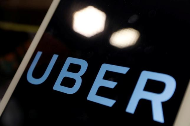 The logo of Uber is seen on an iPad, during a news conference to announce Uber resumes ride-hailing service, in Taipei, Taiwan April 13, 2017. REUTERS/Tyrone Siu
