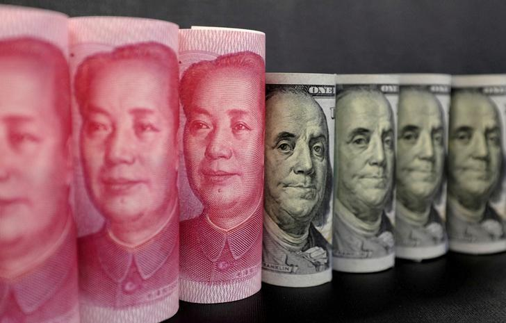 FILE PHOTO: U.S. 100 dollar banknotes and Chinese 100 yuan banknotes are seen in this picture illustration in Beijing, China, January 21, 2016. REUTERS/Jason Lee/Illustration/File Photo