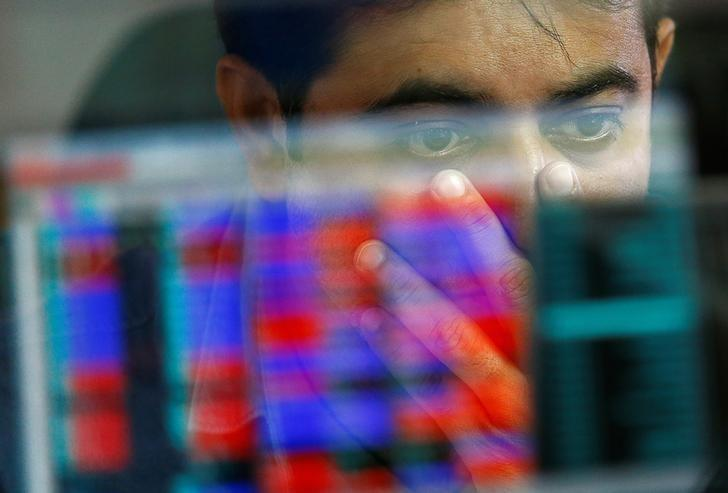 A broker reacts while trading at his computer terminal at a stock brokerage firm in Mumbai, India, November 9, 2016. REUTERS/Danish Siddiqui/File Photo